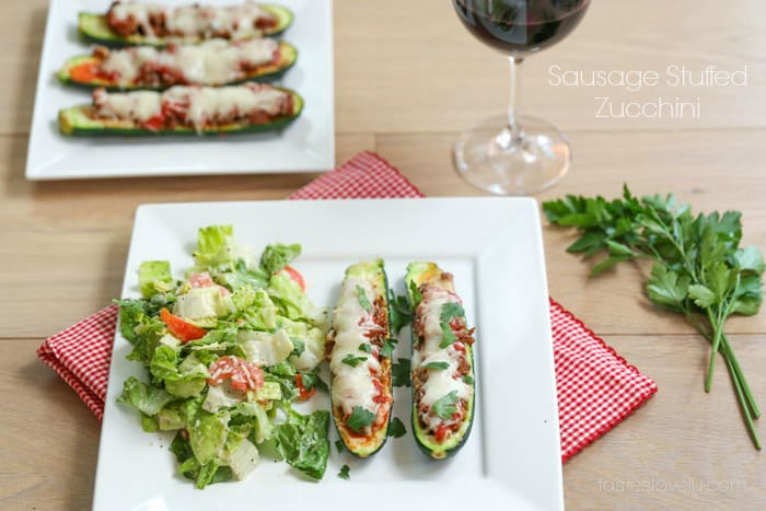 Italian style sausage stuffed zucchini topped with tomato sauce and ...