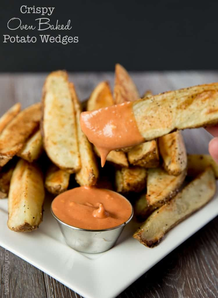Crispy oven baked potato wedges with a spicy ketchup sriracha