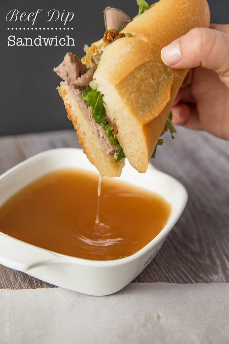 Beef dip sandwich with gruyere cheese and grilled onions
