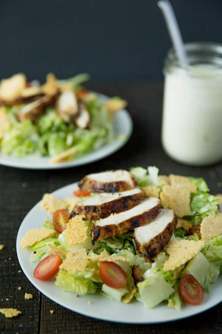 Lemon pepper chicken caesar salad with creamy caesar dressing and parmesan frico croutons