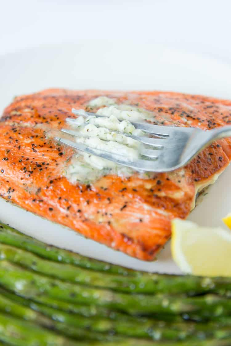 Pan seared salmon topped with a dill & garlic compound butter. 15 minute recipe!