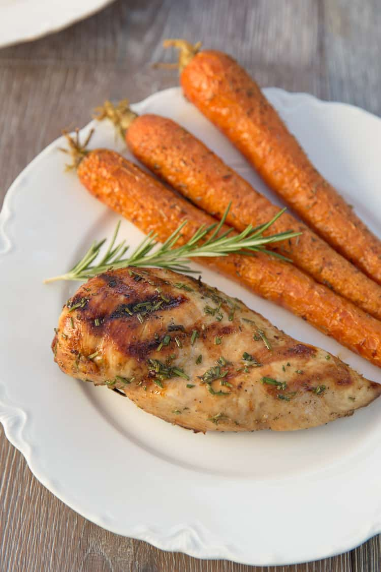 Grilled lemon rosemary chicken that has been marinated in white wine. Perfect light summer dinner!