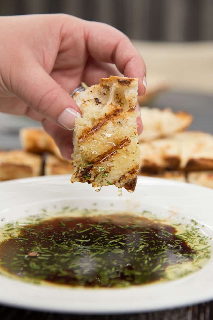 Garlic rubbed grilled bread with rosemary dipping oil. Perfect summer appetizer or side dish!