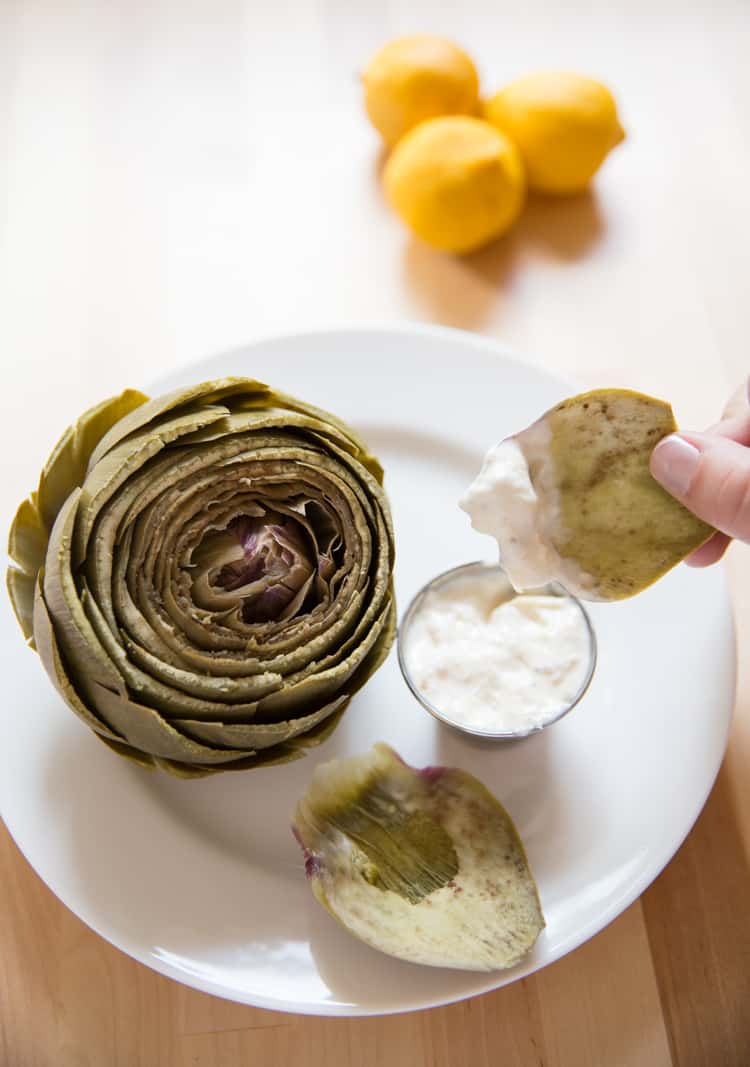 Steamed artichokes with a delicious lemon garlic aioli. The best artichoke dipping sauce!