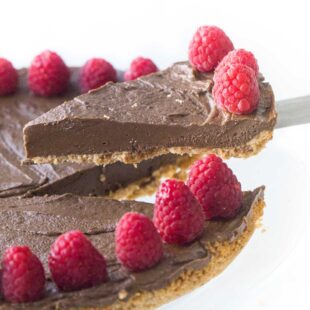 lifting a slice of healthy chocolate tart