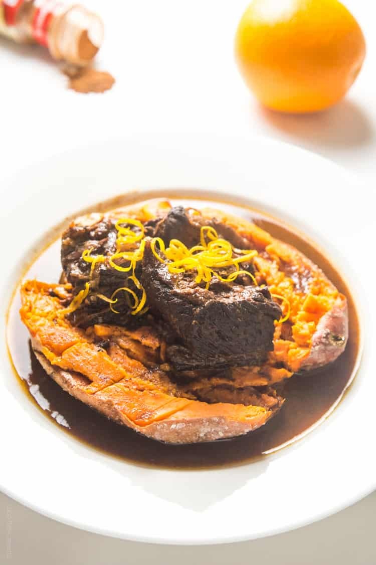 Slow cooker Moroccan Braised Short Ribs - tender, flavorful short ribs cooked in an orange cinnamon sauce, served over a baked sweet potato #paleo #whole30 #glutenfree #lowcarb