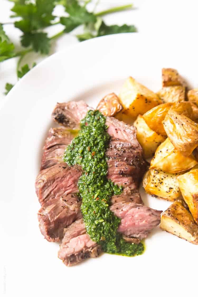 Skirt steak with chimichurri sauce - a delicious (and affordable!) steak dinner topped with a cilantro parsley mixture. #paleo #whole30 #glutenfree #lowcarb