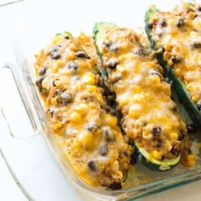 Quinoa & Black Bean Enchilada Stuffed Zucchinis (gluten free) | tasteslovely.com