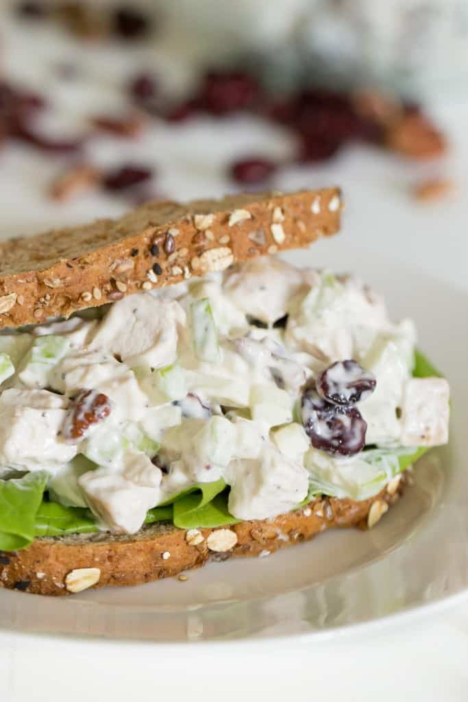 Fall Chicken Salad with tart Granny Smith apples, sweet dried cranberries, and crunchy toasted pecans. Serve it as a sandwich on soft whole wheat bread or in lettuce as a lettuce wrap. Perfect autumn lunch!