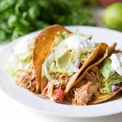 Slow Cooker Mexican Shredded Chicken Tacos - juicest and most delicious chicken tacos ever! (gluten free) | tasteslovely.com