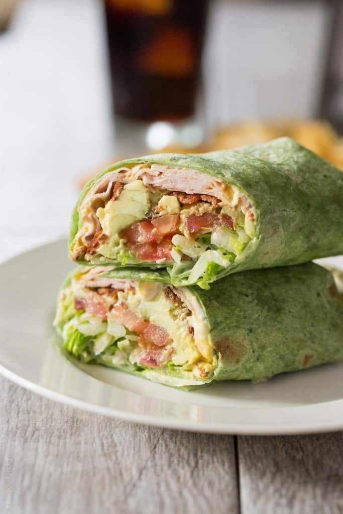 turkey club wrap in a green spinach tortilla