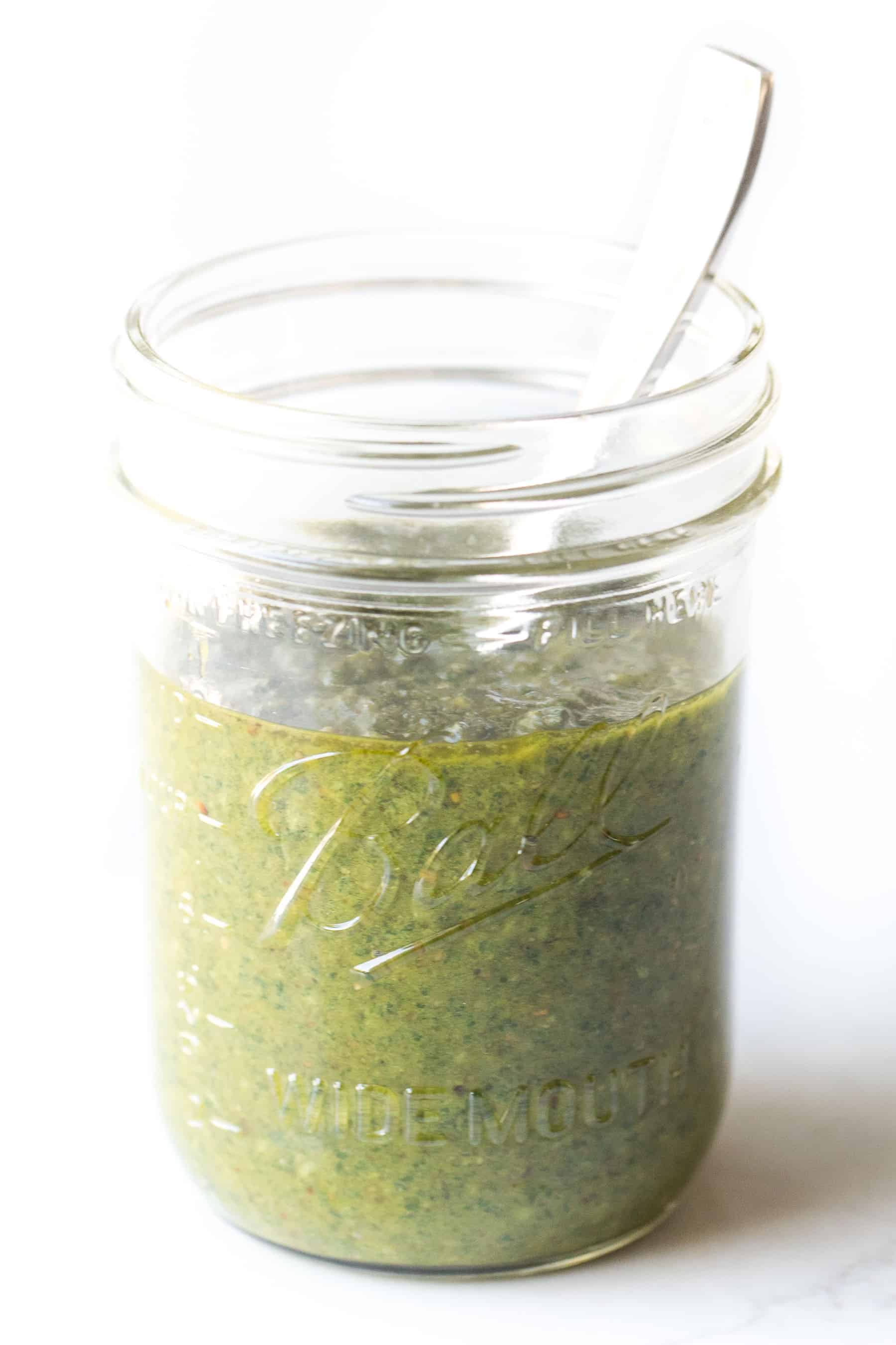 pesto in a mason jar on a white background