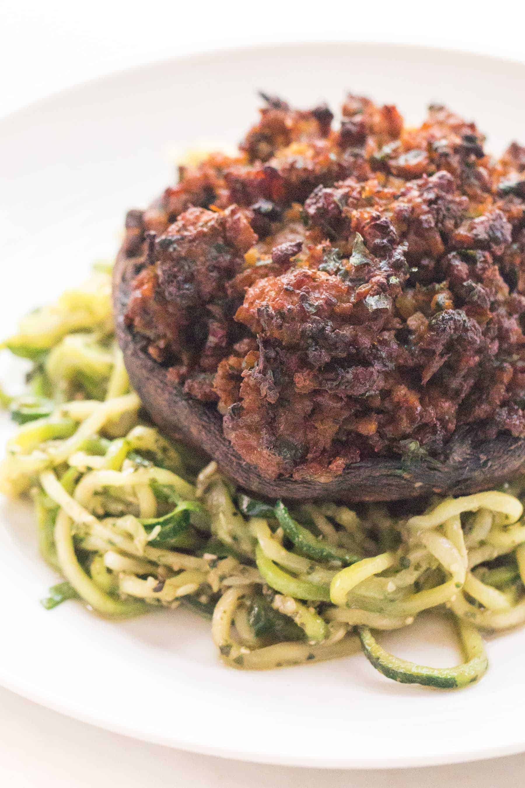 sausage stuffed portobello mushrooms over zucchini noodles