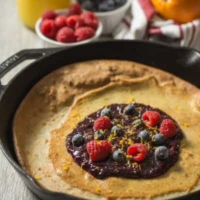 Paleo Dutch Baby with Orange Berry Compote | tasteslovely.com
