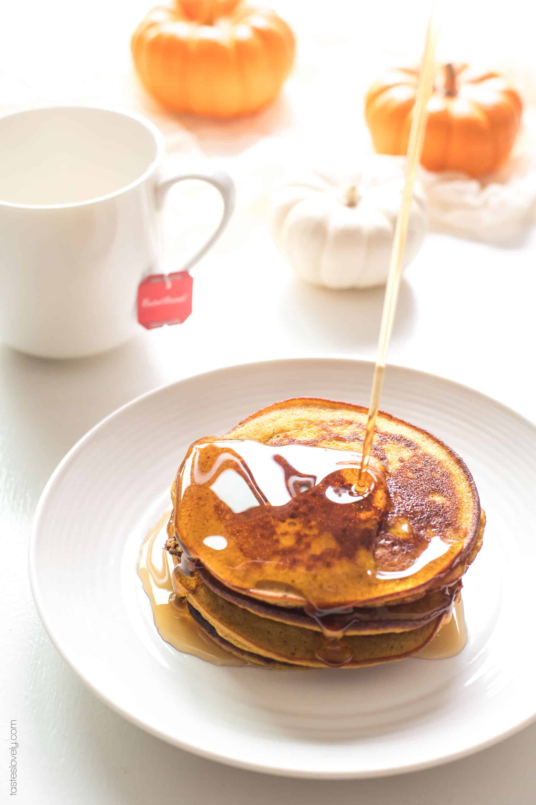 Paleo Pumpkin Pancakes made with almond flour and coconut flour. Light and fluffy pancakes packed with pumpkin flavor! Paleo, gluten free, grain free, dairy free, refined sugar free, clean eating.