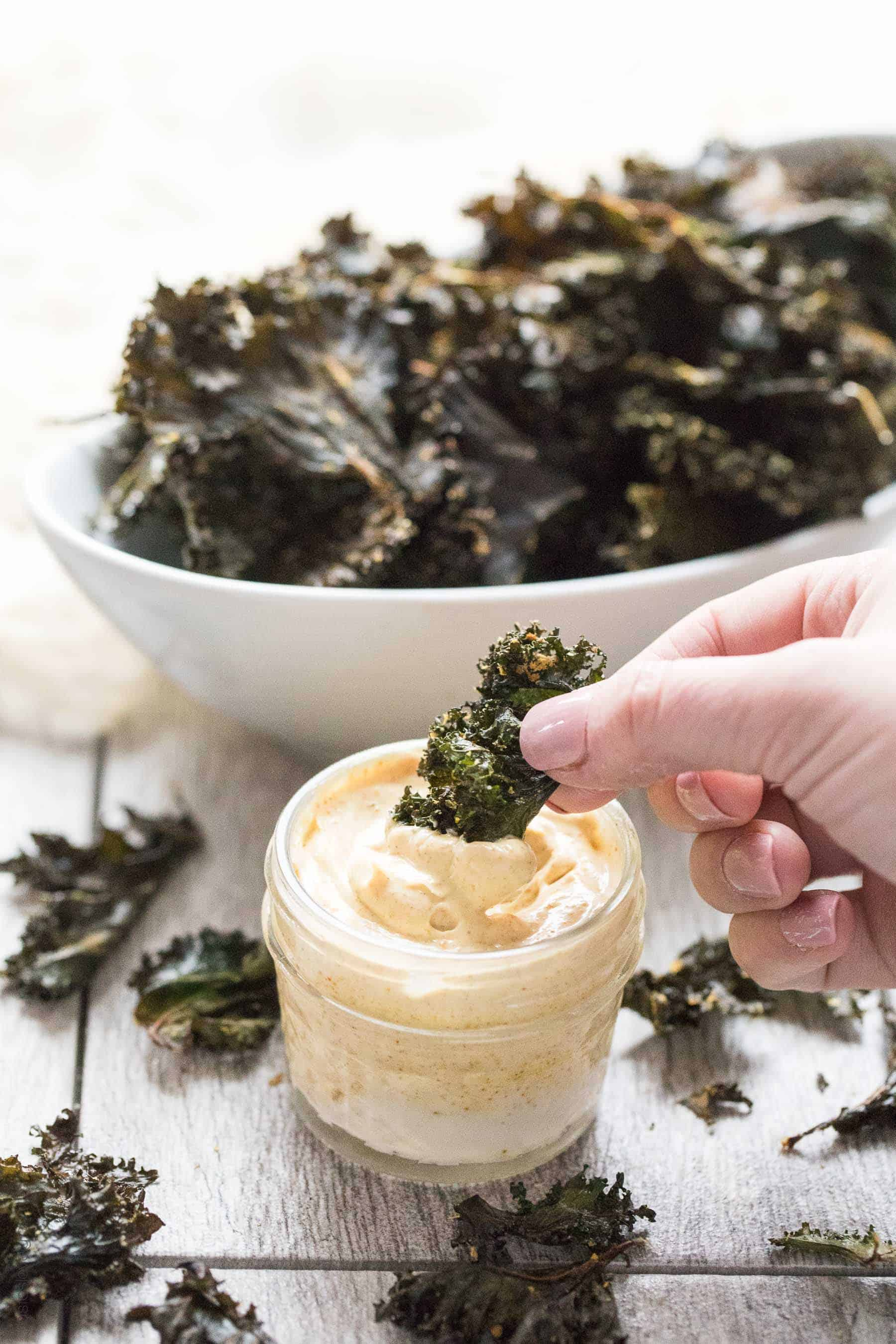Roasted Kale Chips with Curry Aioli - a crispy, crunchy salty snack that is Paleo & Whole30. Ready in 20 minutes. Served with a curry aioli dipping sauce.