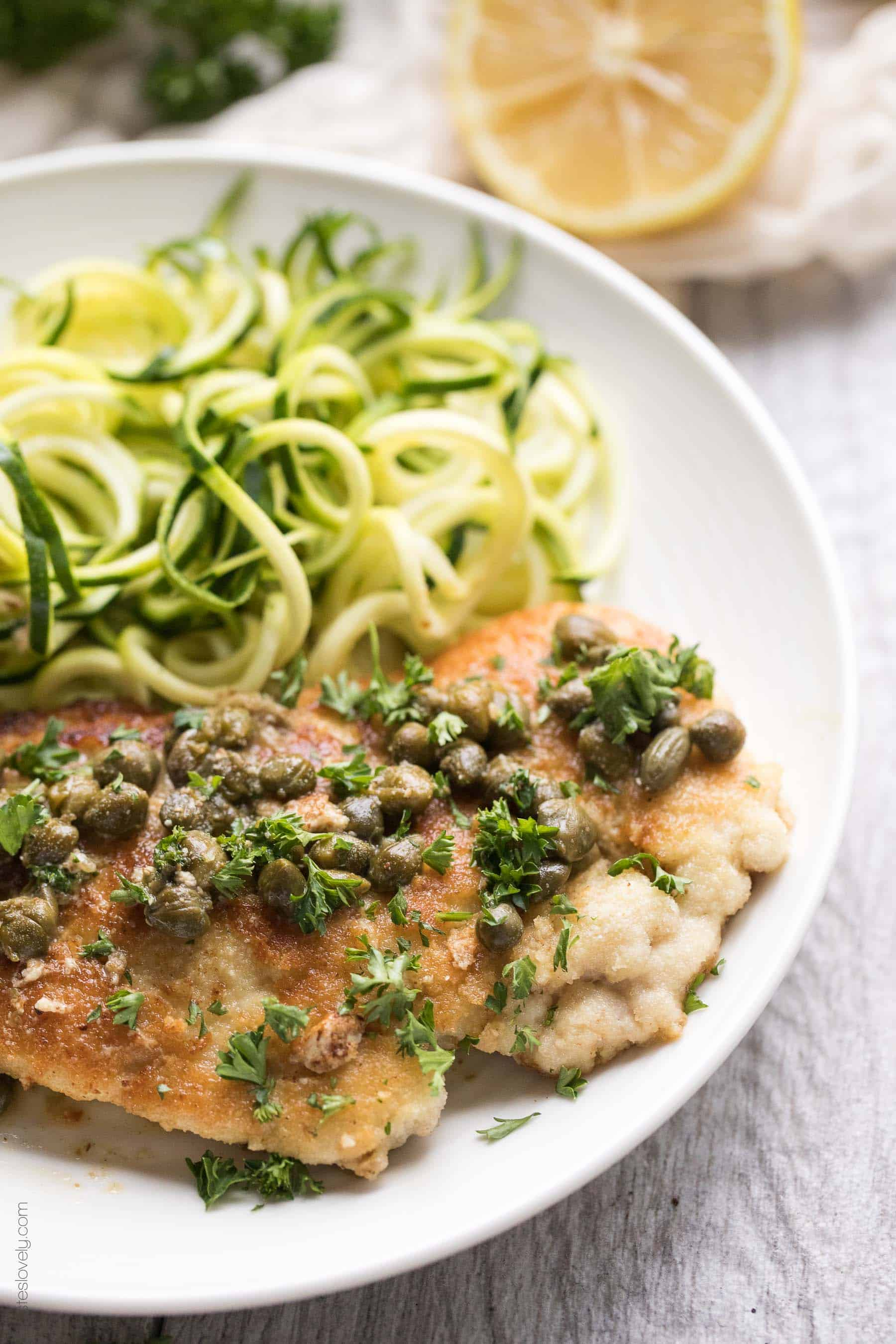 Paleo & Whole30 Chicken Piccata - a 15 minute dinner recipe! Dredged in almond flour and served with a lemony caper sauce. Gluten free, grain free, dairy free, sugar free, clean eating.