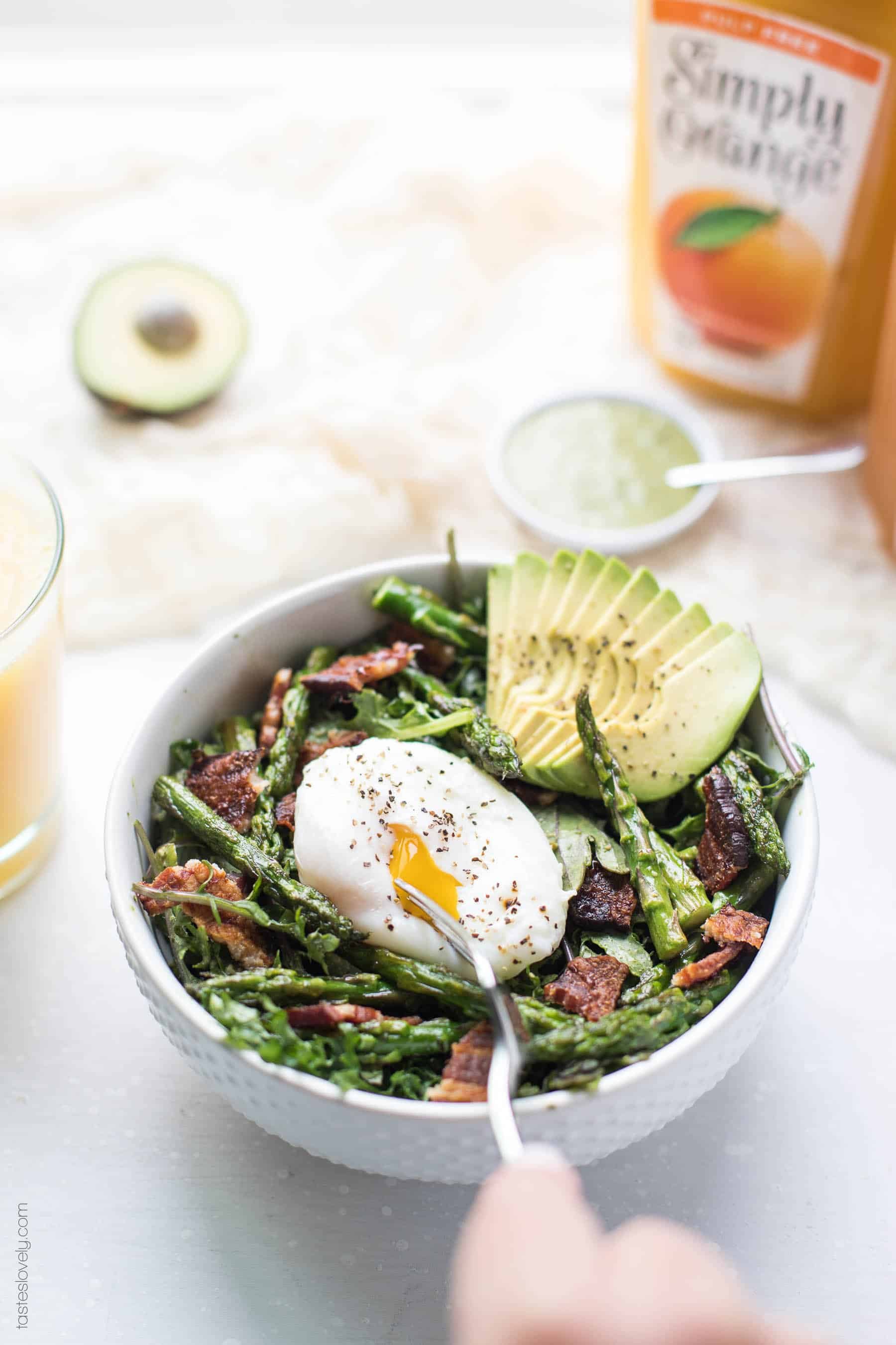 Paleo + Whole30 Brunch Kale Salad - baby kale tossed in an herby green dressing topped with bacon, asparagus and a poached egg (gluten free, grain free, dairy free, sugar free, clean eating)