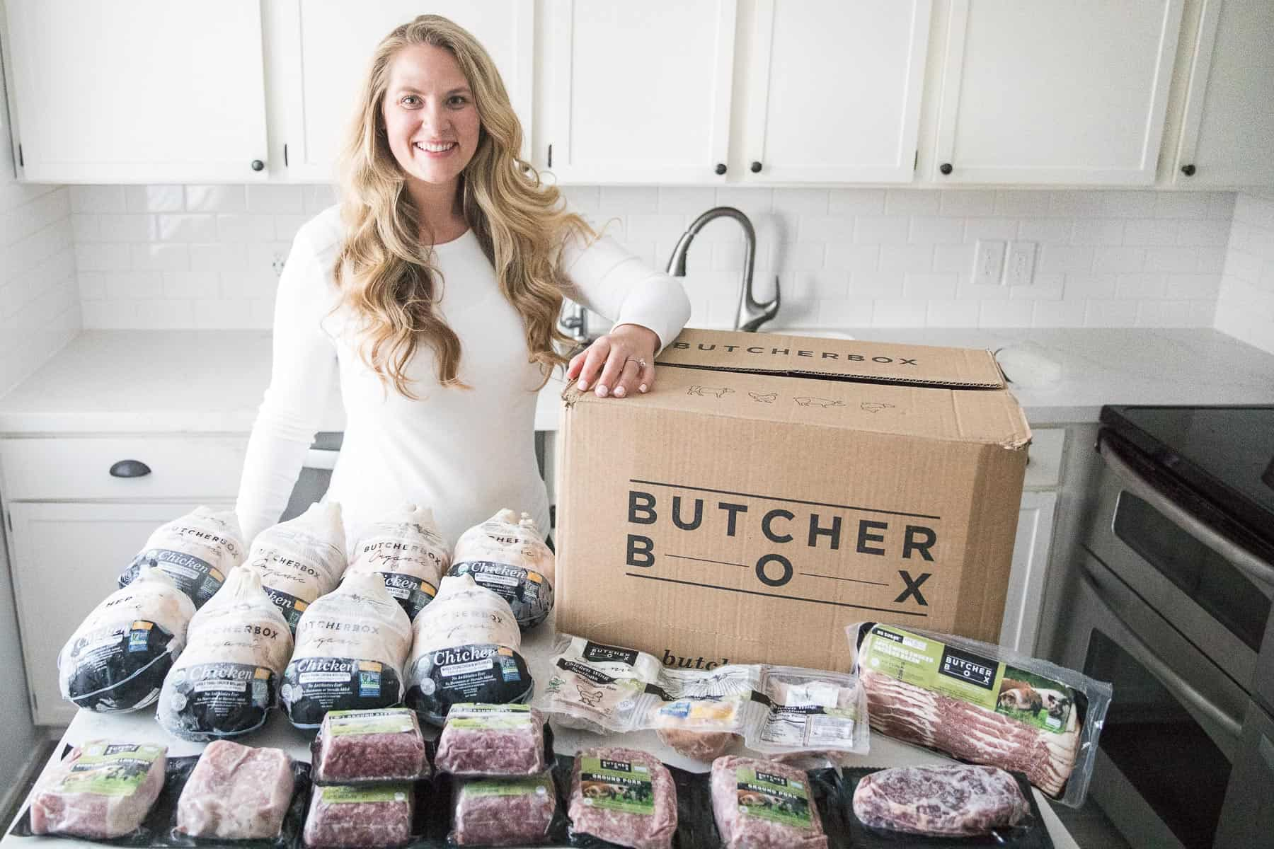 girl standing with a butcherbox order of meat