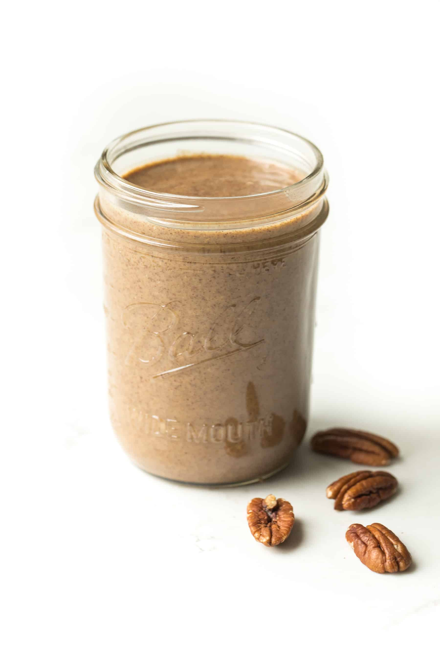 a mason jar of homemade pecan butter