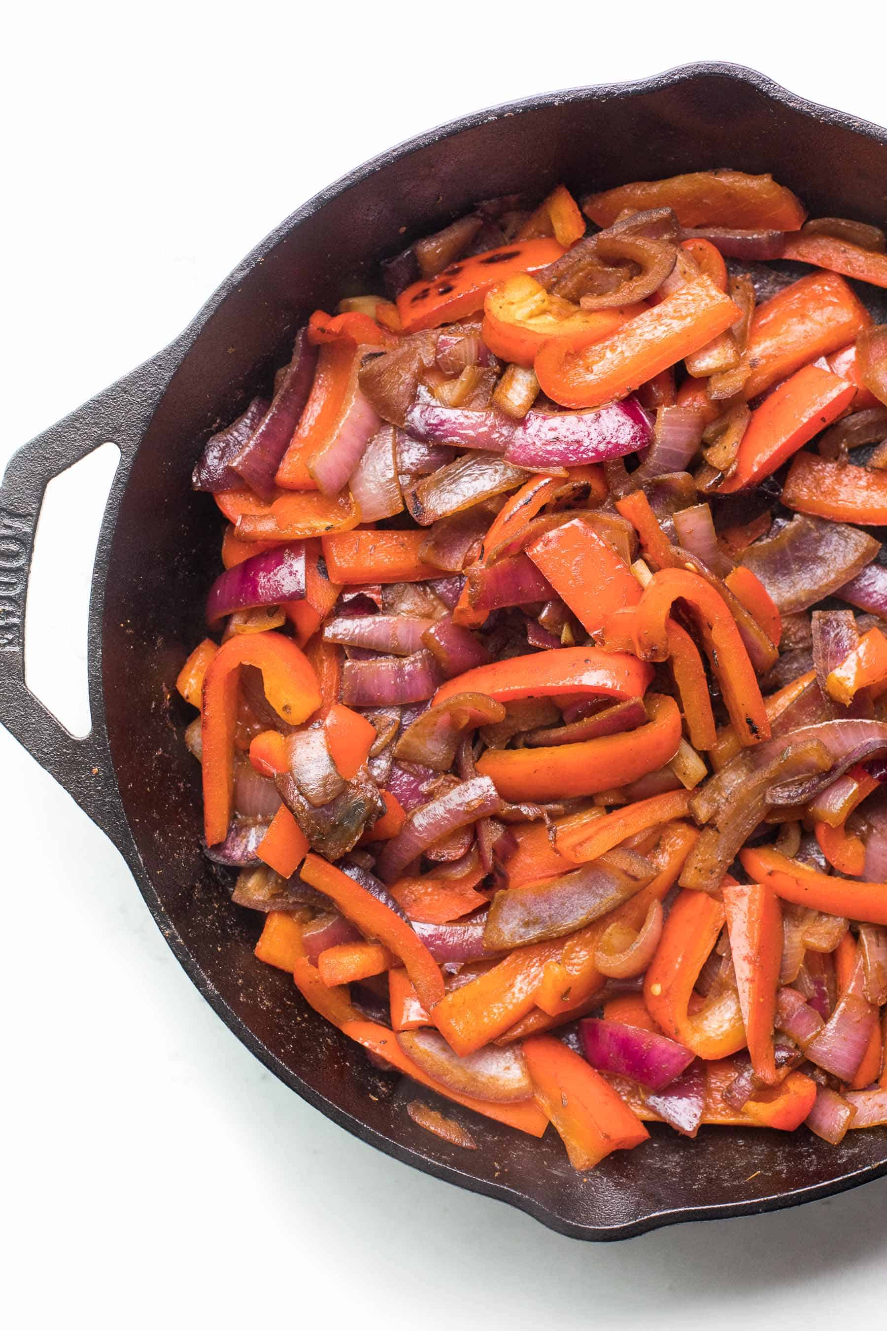 fajita veggies in a cast iron skillet