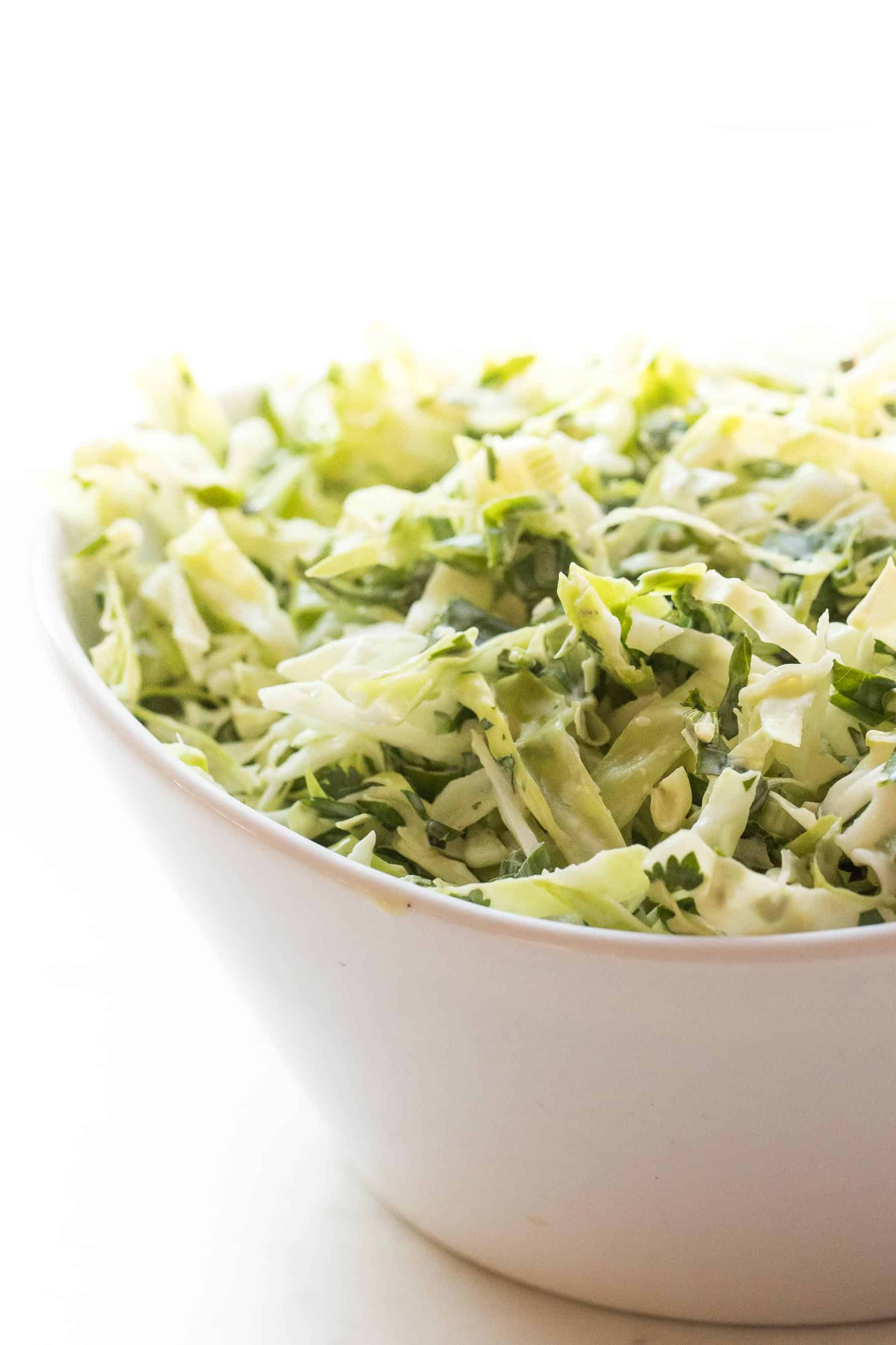 coleslaw in a white bowl and white background