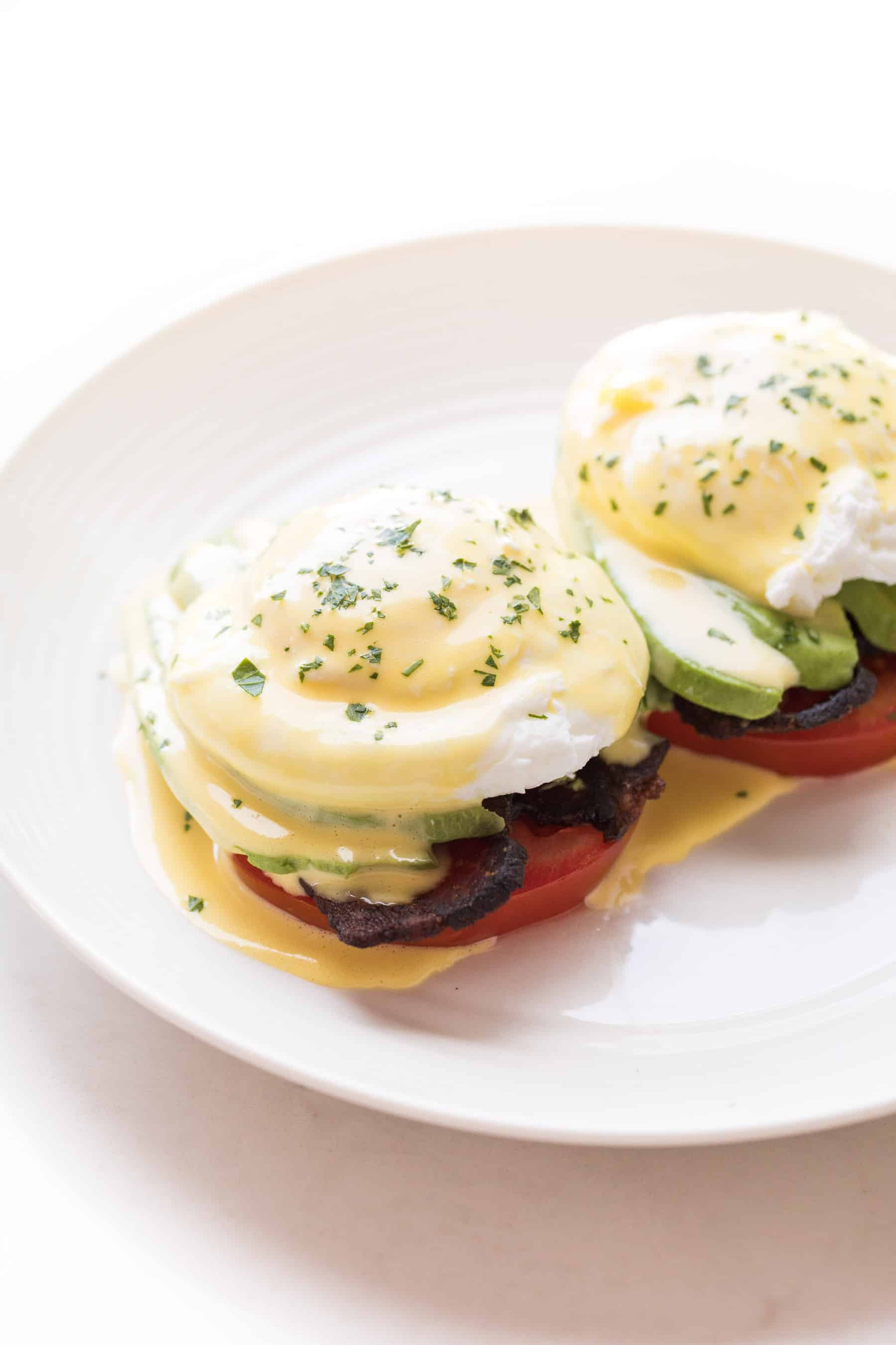 eggs benedict on a white plate