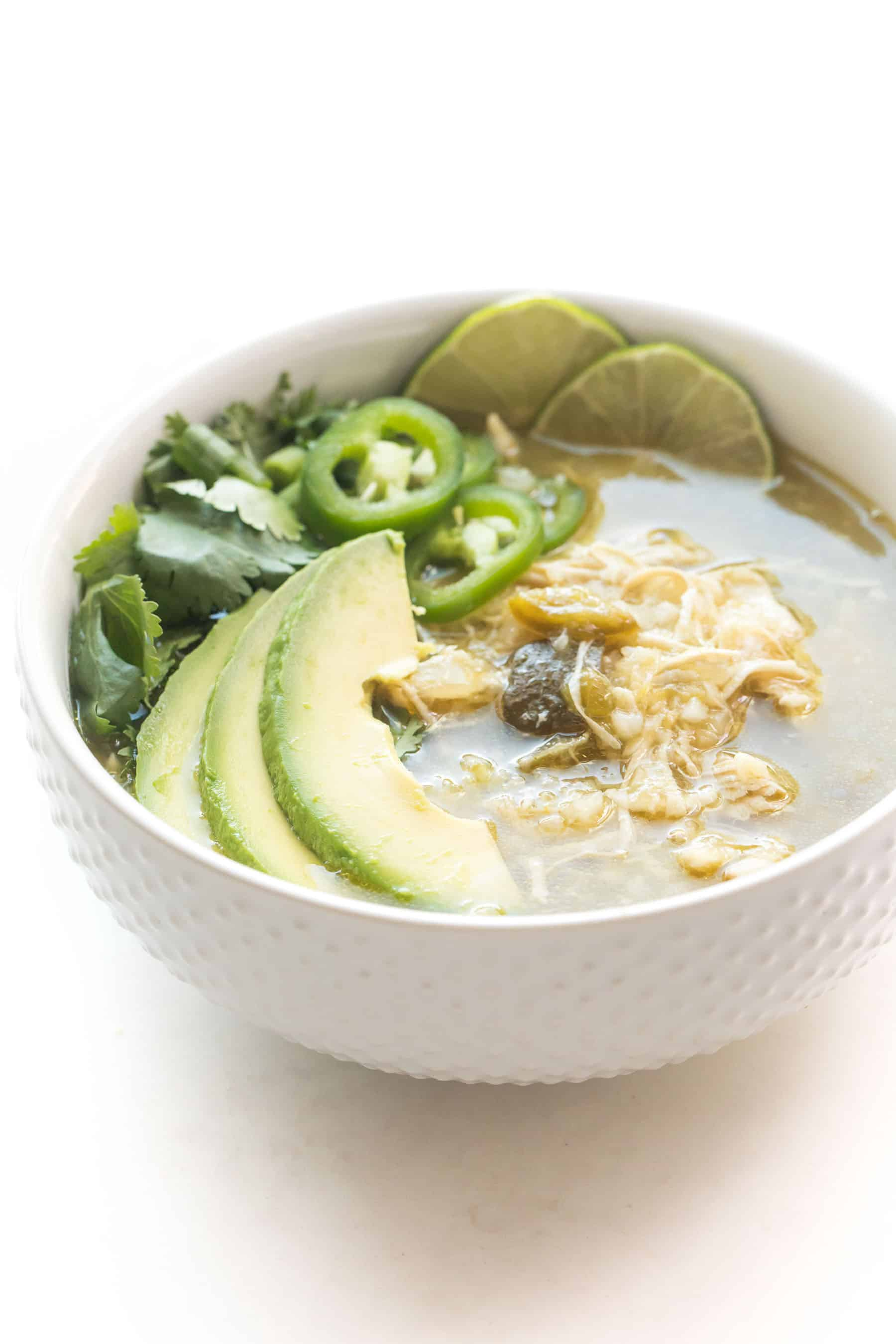 green verde chicken chili in a white bowl on a white background