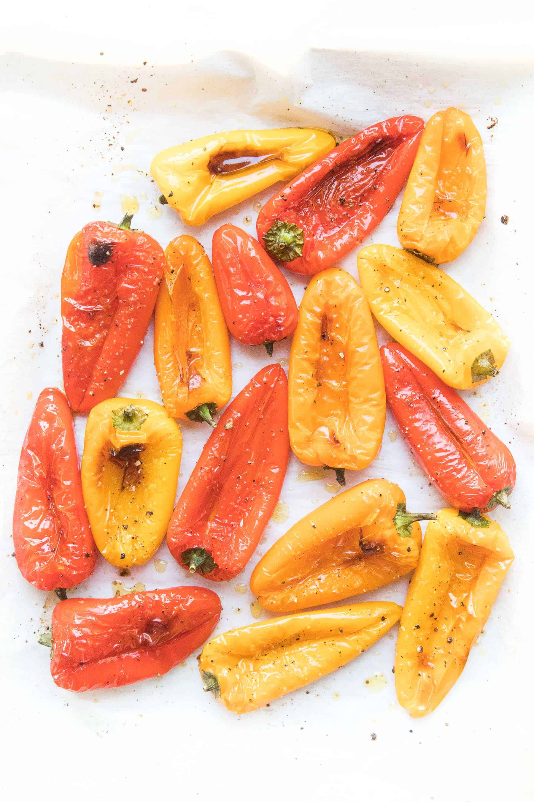 roasted mini bell peppers on parchment paper