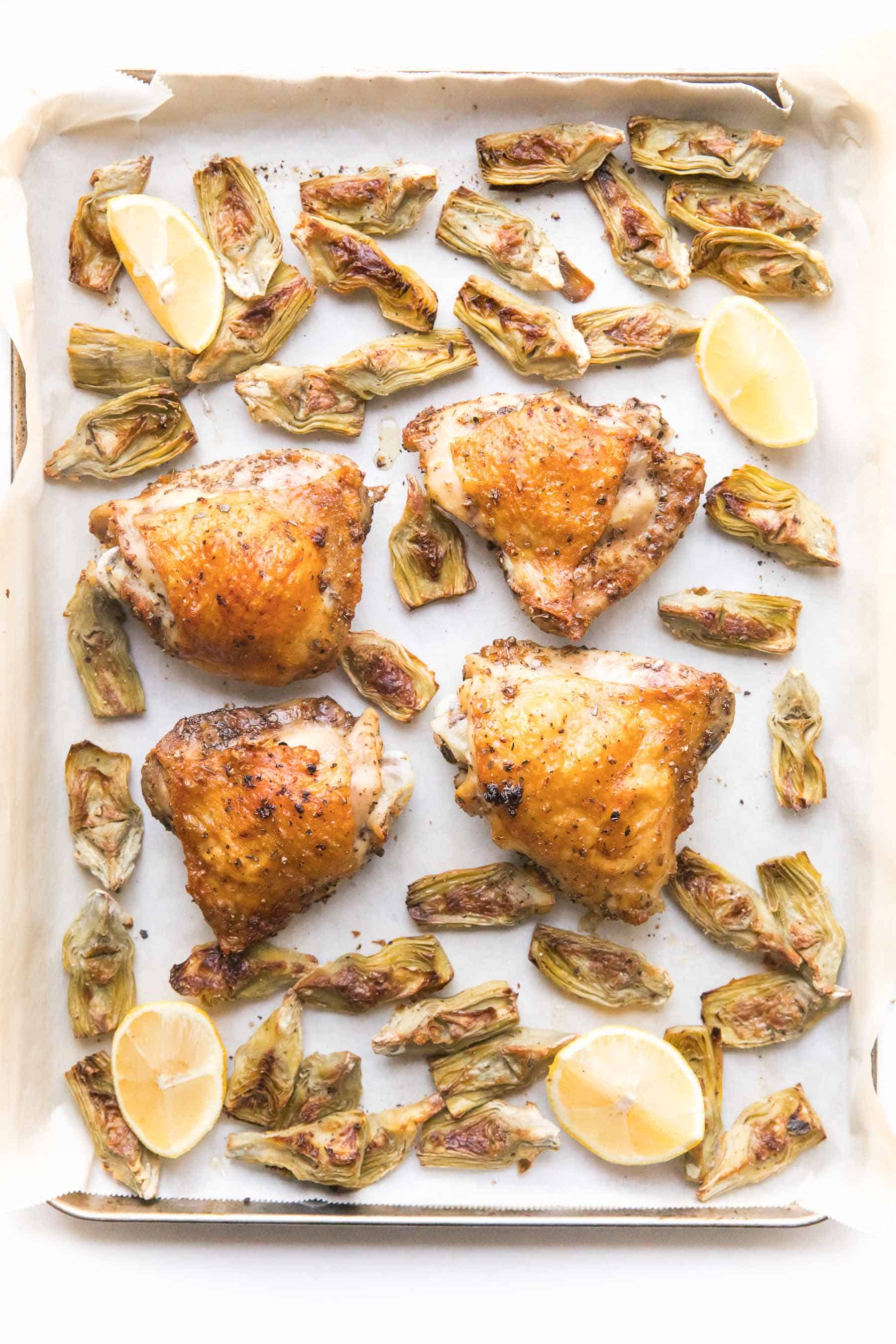 Roasted chicken and artichokes on a sheet pan