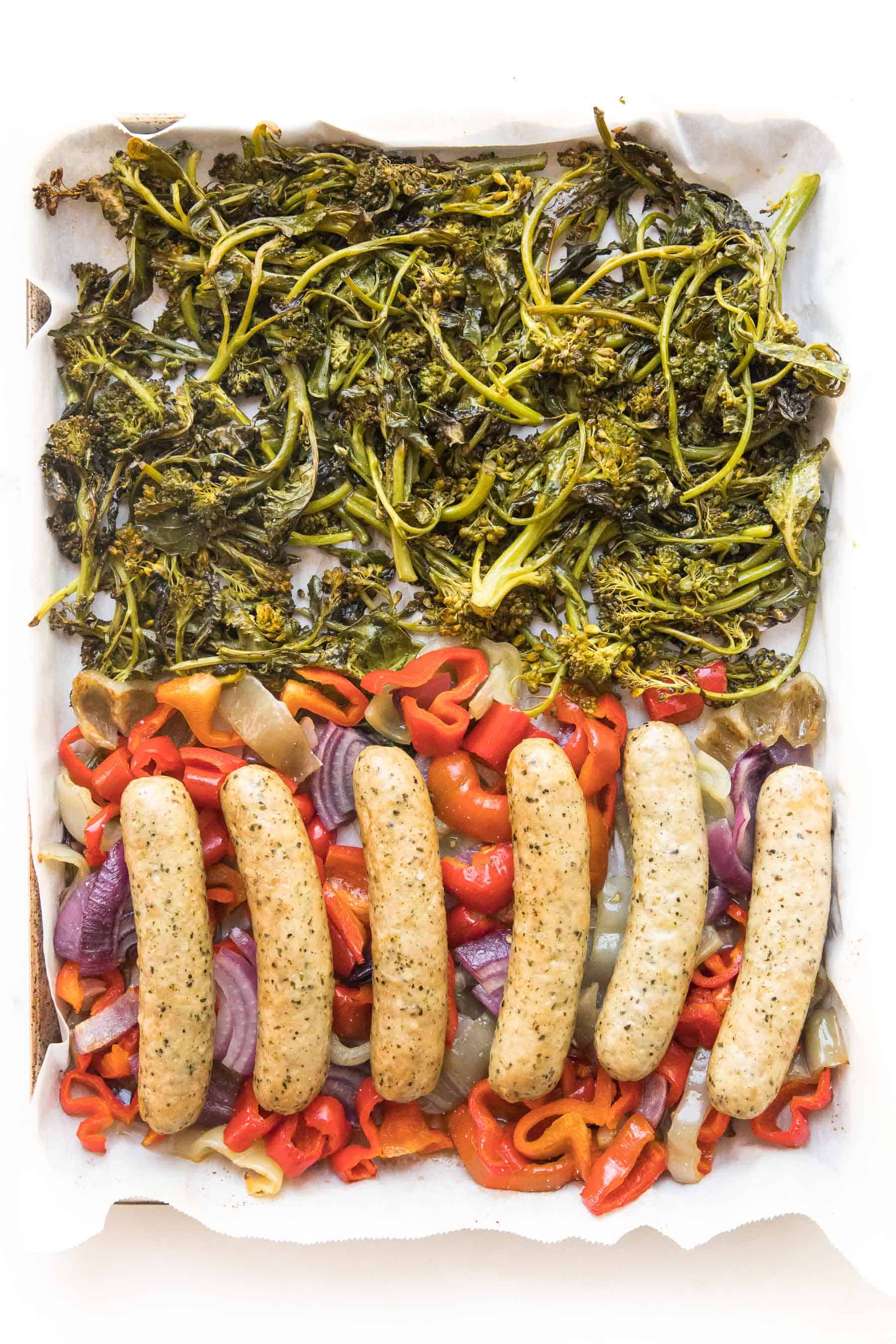 sausages and veggies on a sheet pan