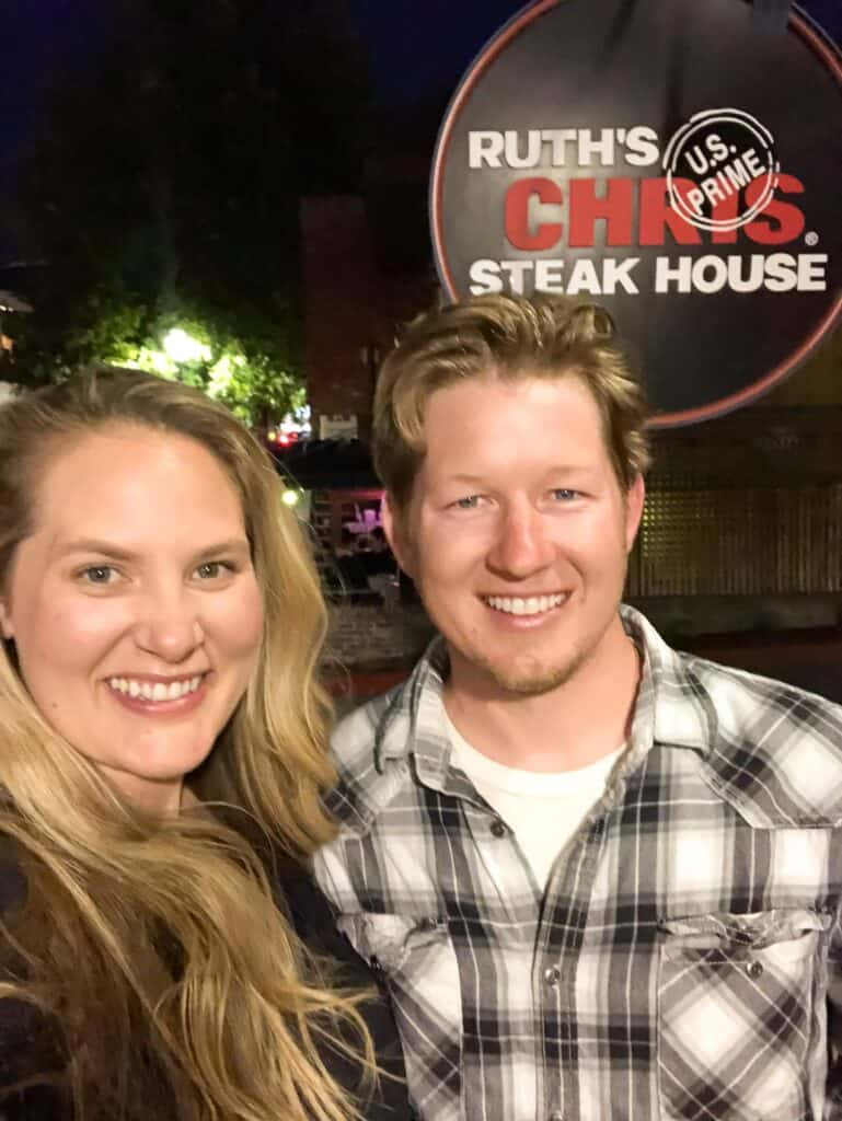 couple standing in front of ruth's chris steakhouse