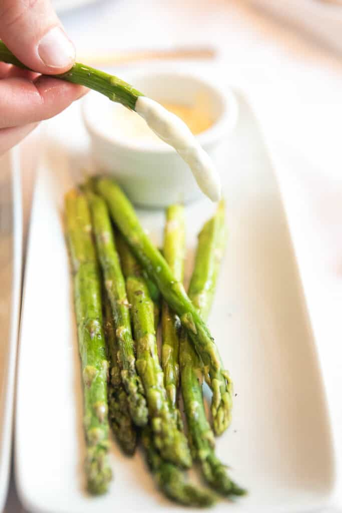 grilled asparagus with hollandaise sauce at ruth's chris steakhouse keto friendly menu