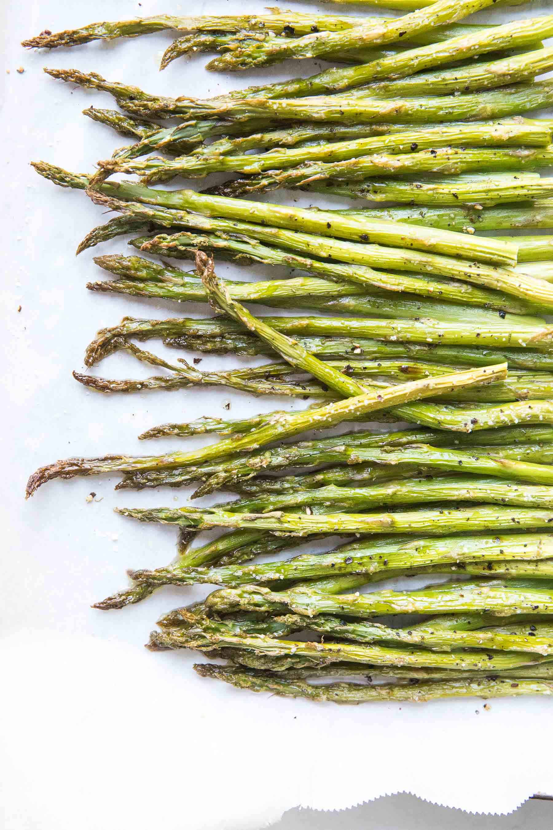 roasted asparagus on a rimmed baking sheet