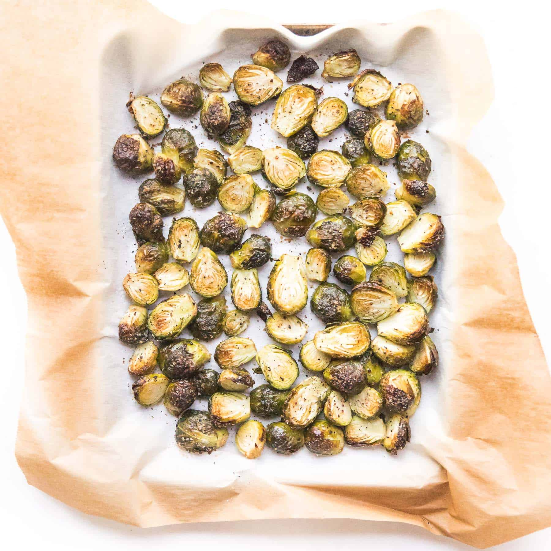 roasted brussels sprouts on a rimmed baking sheet
