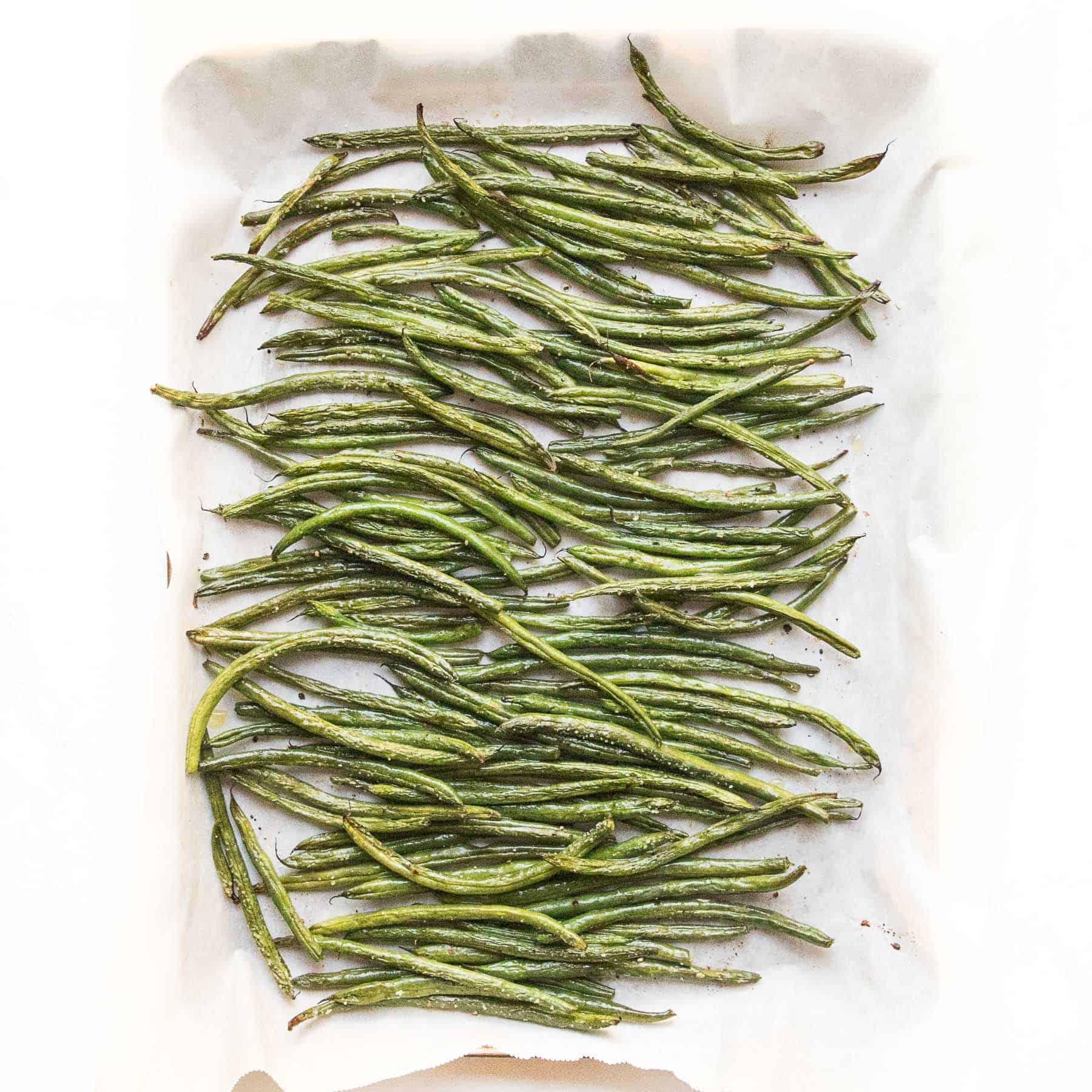 roasted green beans in a rimmed baking sheet
