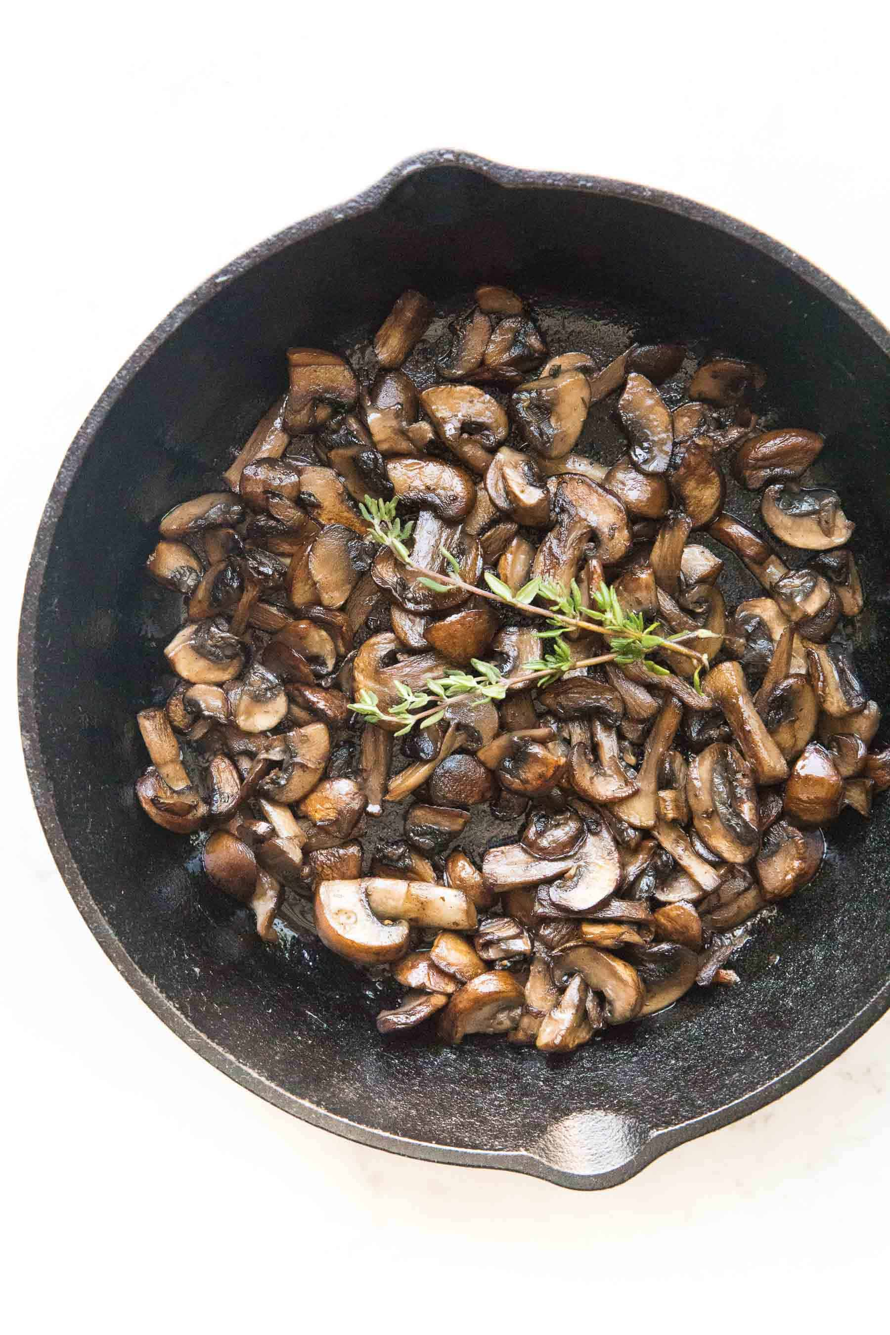 sauteed mushrooms in a cast iron skillet