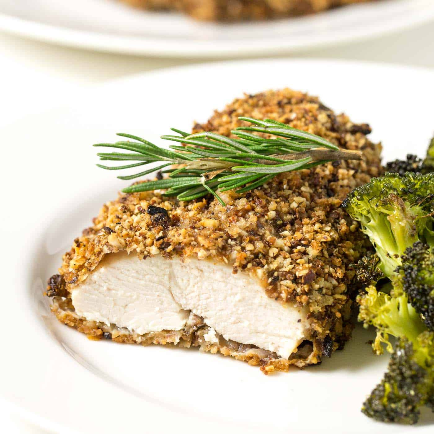rosemary almond crusted chicken on a white plate