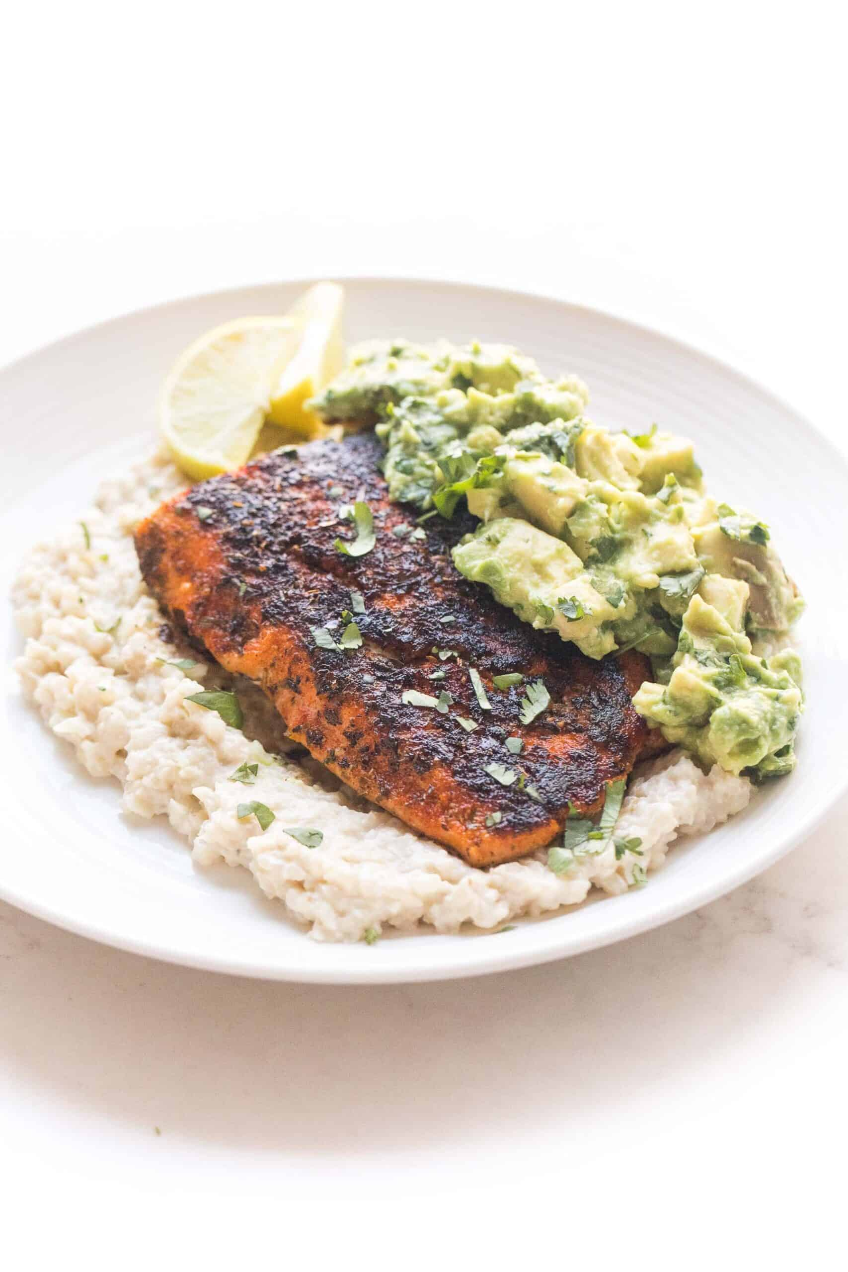whole30 + keto blackened salmon over cauliflower risotto with chunky avocado topping