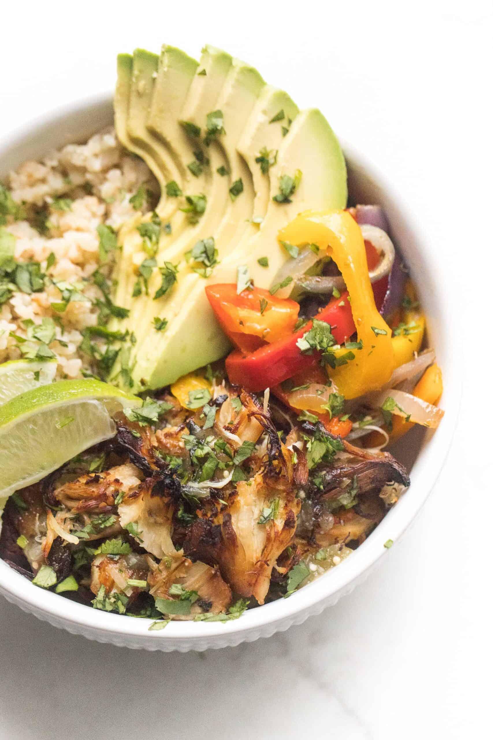 crispy verde chicken burrito bowl on a white background