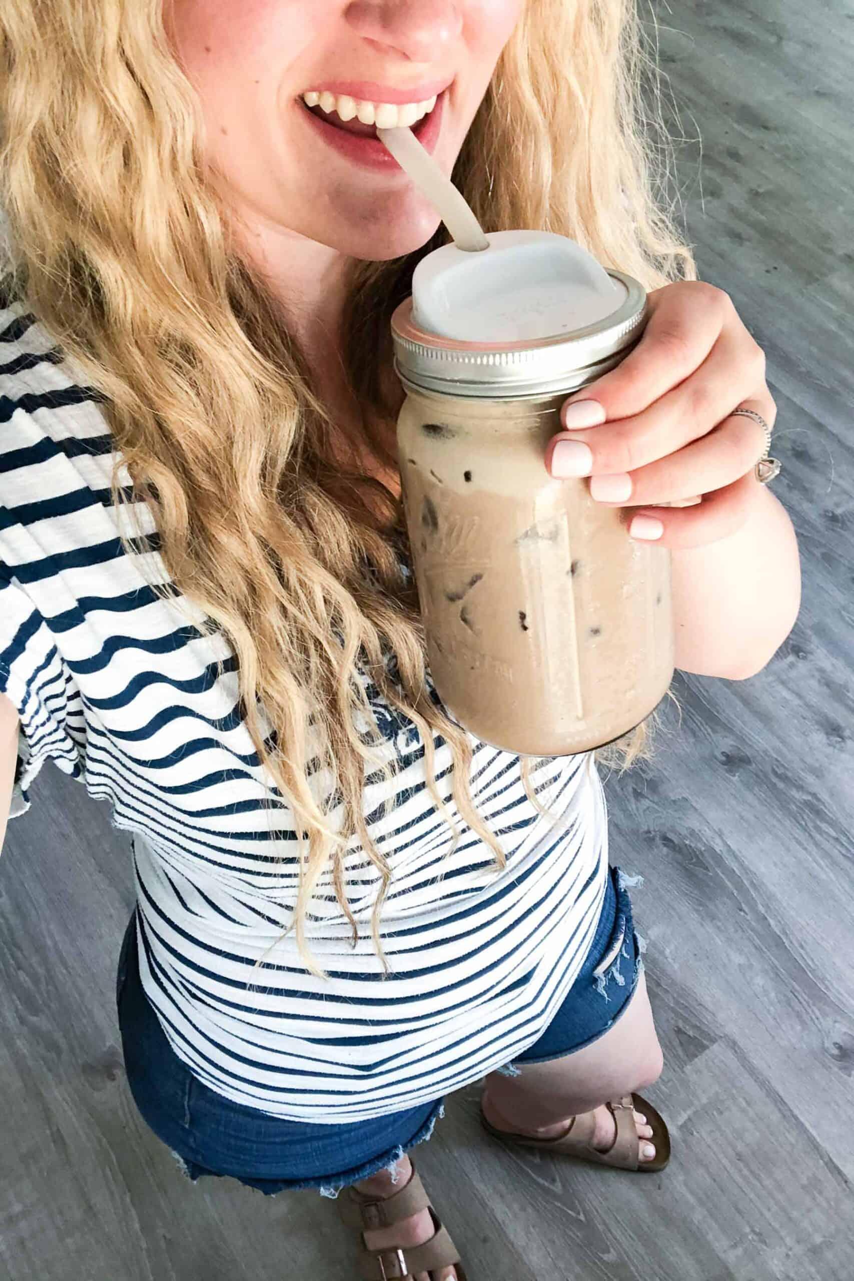 girl holding an iced mocha
