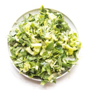 green salad on a white plate and background