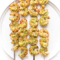 pesto shrimp kabobs on a white plate
