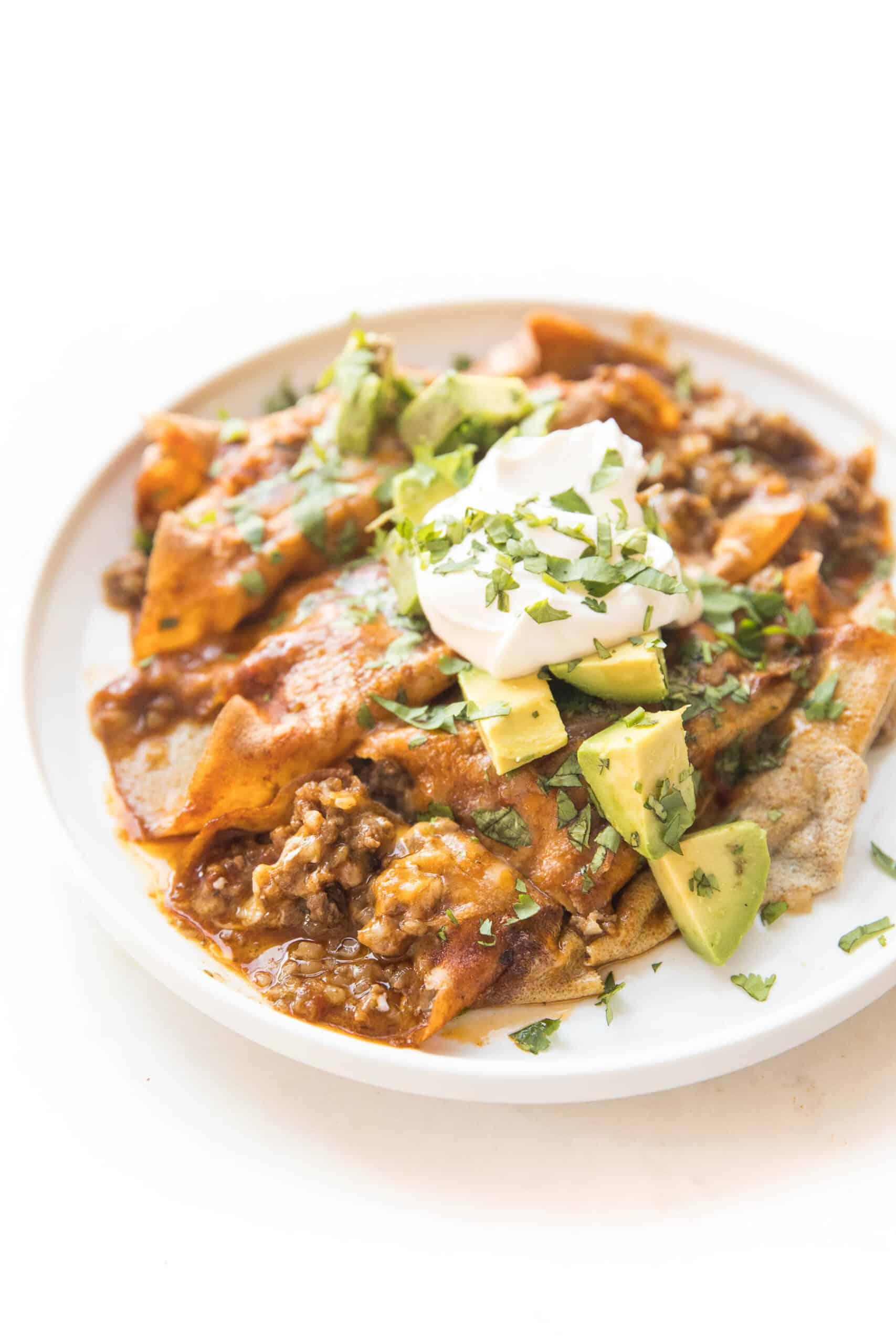 keto beef enchiladas on a white plate