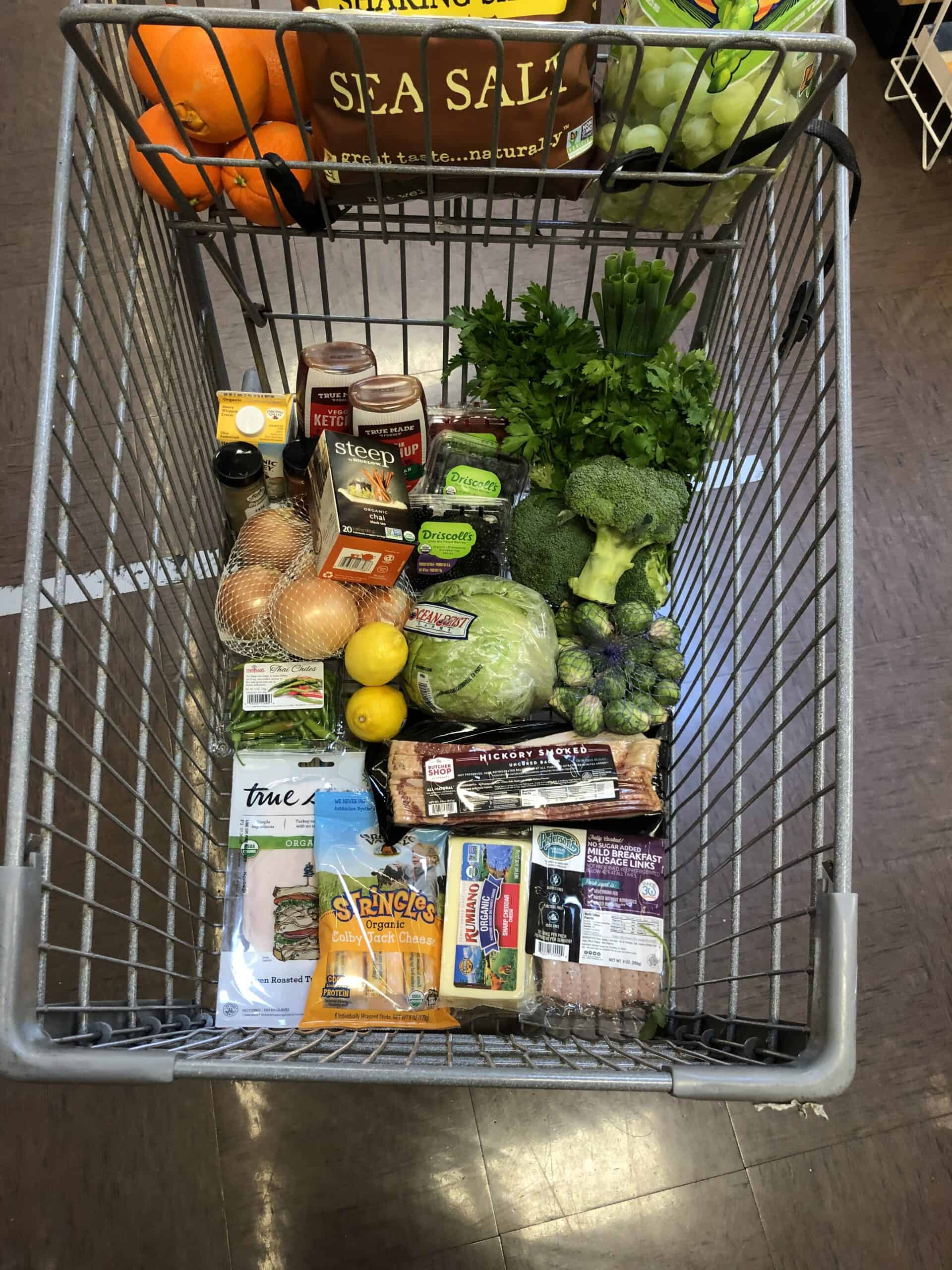 keto grocery haul at sprouts in a grocery cart