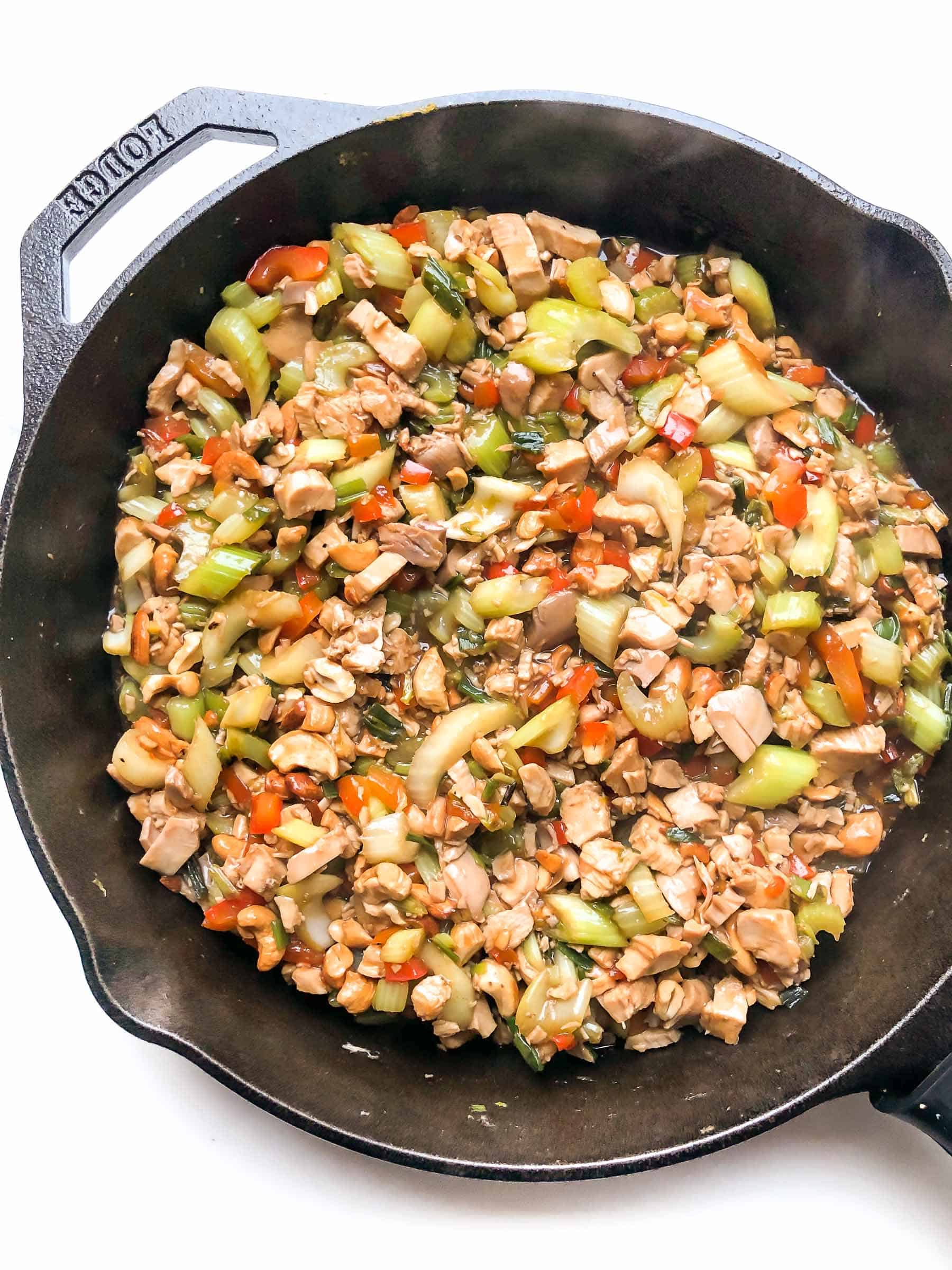 CHICKEN AND CELERY STIR FRY IN A CAST IRON SKILLET