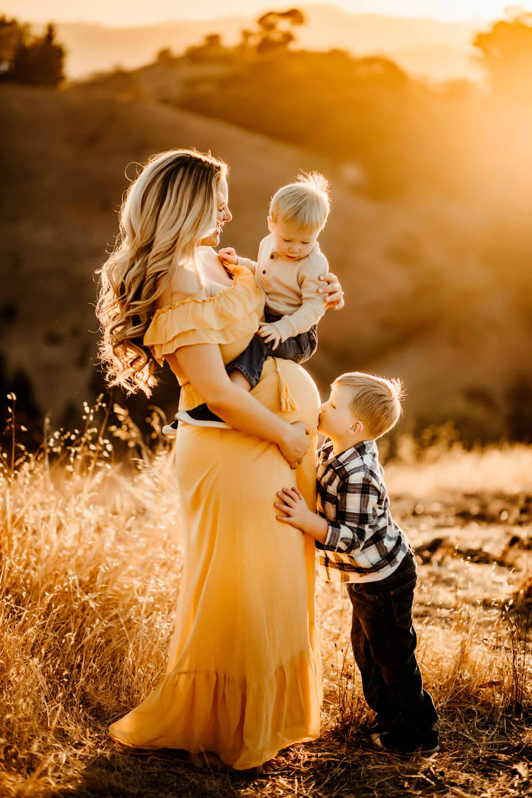 pregnant women in yellow dress with 2 little boys, boy mom of 3, sunset photo