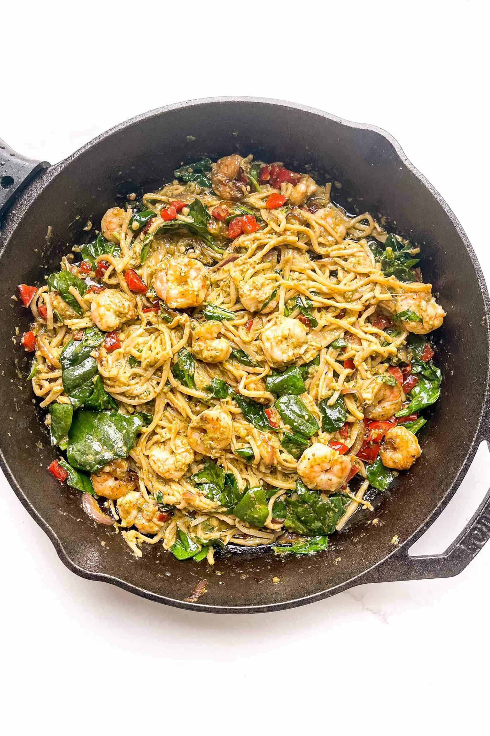 pesto shrimp pasta in a cast iron skillet