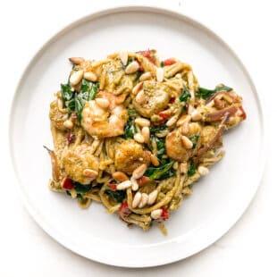 pesto shrimp pasta on a white plate