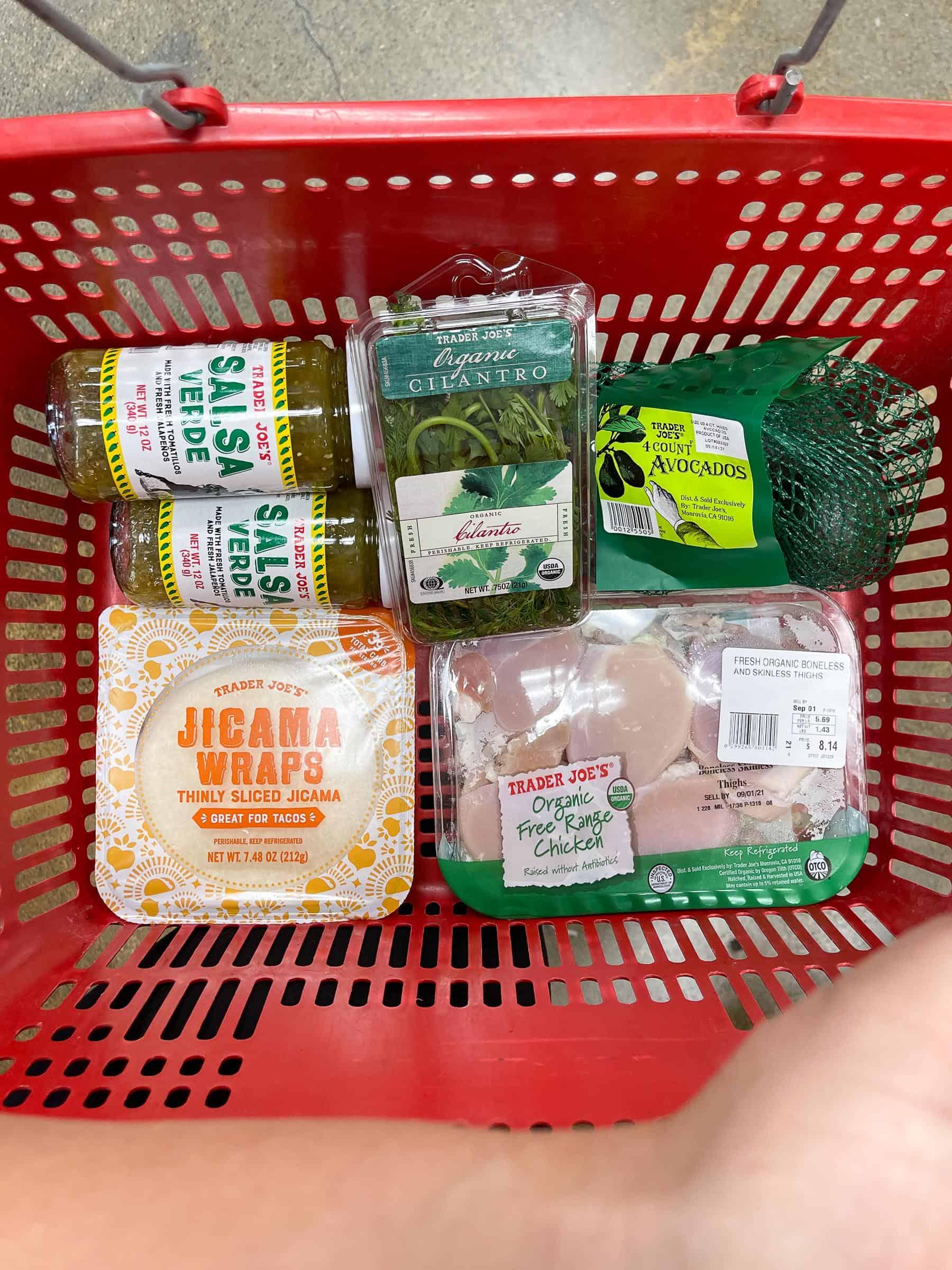 red trader joe's shopping basket with ingredients for keto crispy verde tacos